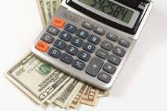 Dinheiro e calculadora americanos Fotos de Stock Royalty Free