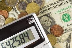 Dinheiro e calculadora americanos Fotografia de Stock
