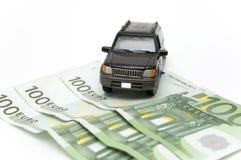 Dinheiro e carro Fotos de Stock Royalty Free