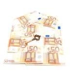 Dinheiro e chave Foto de Stock Royalty Free