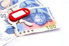 Dinheiro e chave Fotografia de Stock