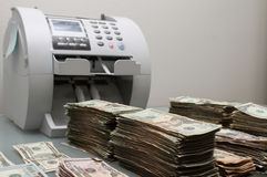 Dinheiro e contador Foto de Stock Royalty Free