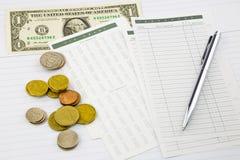 Dinheiro e despesas do salário Fotografia de Stock