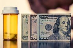 Dinheiro e medicamentação Fotografia de Stock Royalty Free