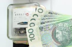Dinheiro e medidor da energia elétrica Fotografia de Stock Royalty Free