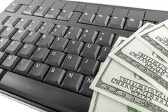 Dinheiro e teclado Foto de Stock