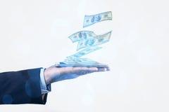 Dinheiro e telefone Imagens de Stock