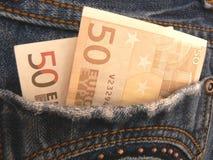 Dinheiro em calças de brim do bolso Fotografia de Stock Royalty Free
