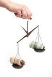 Dinheiro em escalas Fotografia de Stock Royalty Free