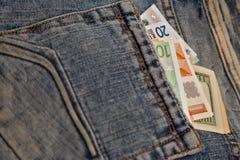 Dinheiro em seu bolso Fotos de Stock Royalty Free