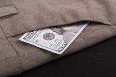 Dinheiro em seu bolso Fotografia de Stock Royalty Free