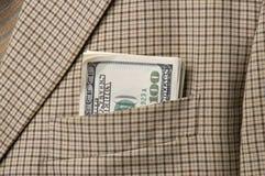 Dinheiro em um bolso fotografia de stock