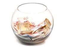 Dinheiro em um frasco de vidro Fotos de Stock