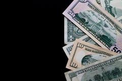 Dinheiro em um fundo preto imagens de stock