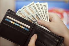 Dinheiro em uma bolsa Fotografia de Stock Royalty Free