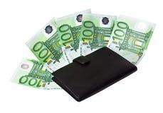 Dinheiro em uma bolsa preta. Fotografia de Stock Royalty Free