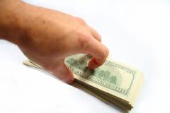 Dinheiro em uma mão Foto de Stock