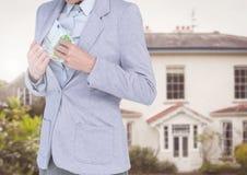 Dinheiro escondendo do homem de negócios corrompido no blazer fotografia de stock