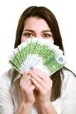 Dinheiro feliz da terra arrendada da mulher nova Imagem de Stock Royalty Free