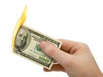 Dinheiro flamejante à disposicão Imagem de Stock Royalty Free