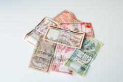 Dinheiro indiano - moedas do banco de Nepal Rastra - notas das rupias de Nepal Fotos de Stock Royalty Free