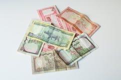 Dinheiro indiano - moedas do banco de Nepal Rastra - notas das rupias de Nepal Imagem de Stock