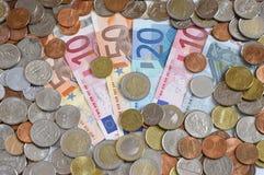 Dinheiro - moedas e notas de banco Foto de Stock