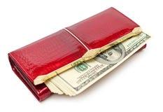 Dinheiro na bolsa vermelha Imagens de Stock Royalty Free