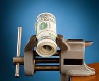 Dinheiro na ferramenta vice Fotos de Stock Royalty Free