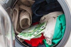 Dinheiro na máquina de lavar foto de stock royalty free