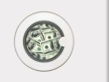 Dinheiro na máquina de lavar imagem de stock
