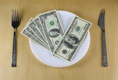 Dinheiro na placa Imagem de Stock