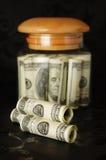 Dinheiro no banco. Imagens de Stock