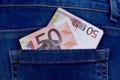Dinheiro no bolso das calças Fotografia de Stock
