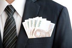 Dinheiro no bolso do terno - moeda do baht tailandês (THB) Foto de Stock
