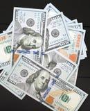 Dinheiro no fundo preto Imagens de Stock Royalty Free