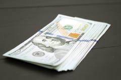Dinheiro no fundo preto Imagem de Stock