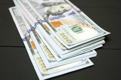 Dinheiro no fundo preto Fotos de Stock