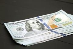 Dinheiro no fundo preto Imagens de Stock