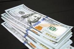 Dinheiro no fundo preto Fotografia de Stock