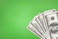 Dinheiro no fundo verde Fotografia de Stock Royalty Free