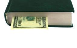 Dinheiro no livro Imagens de Stock Royalty Free
