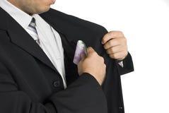 Dinheiro no terno do bolso Imagens de Stock Royalty Free