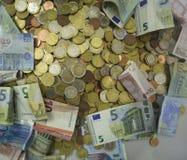 Dinheiro para a caridade e o financiamento Fotografia de Stock Royalty Free
