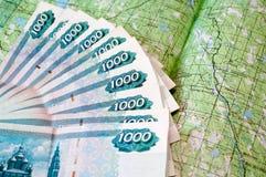 Dinheiro para um mapa Imagem de Stock