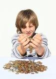 Dinheiro pooring do menino Fotos de Stock