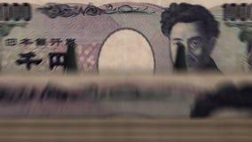 """Dinheiro que conta o †da máquina """"1000 ienes video estoque"""