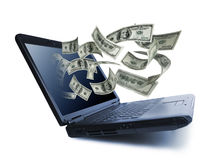 Dinheiro que derrama para fora de um computador portátil Fotografia de Stock Royalty Free