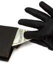 Dinheiro que está sendo tomado fora da bolsa Imagem de Stock