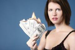 Dinheiro a queimar-se Imagens de Stock